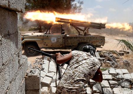 Libyan forces allied with the U.N.-backed government fire weapons during a battle with IS fighters in Sirte,
