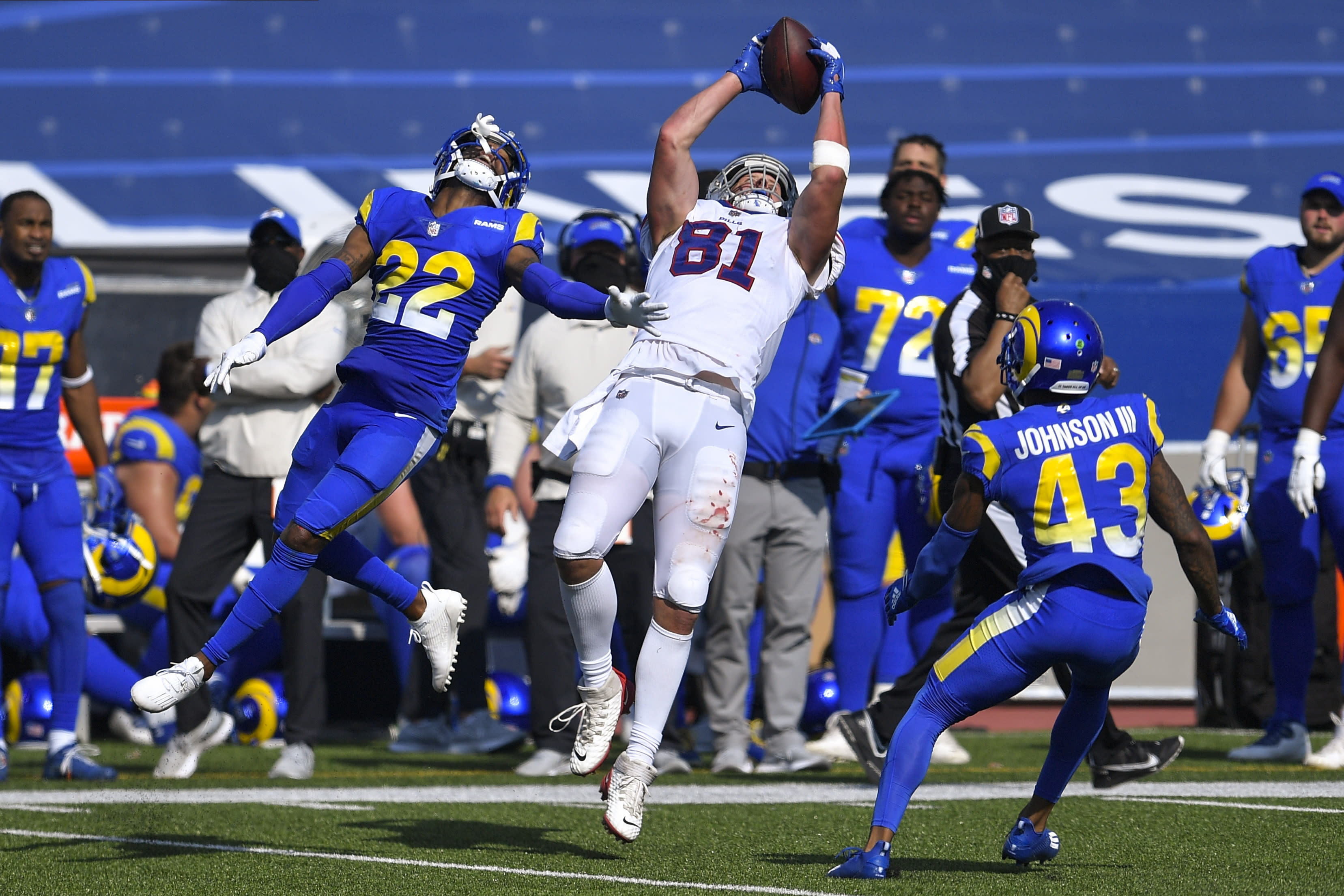 Buffalo Bills tight end Tyler Kroft (81) catches a pass in front of Los Angeles Rams' Troy Hill (22) and John Johnson (43) during the second half of an NFL football game Sunday, Aug. 26, 2018, in Orchard Park, N.Y. (AP Photo/Adrian Kraus)