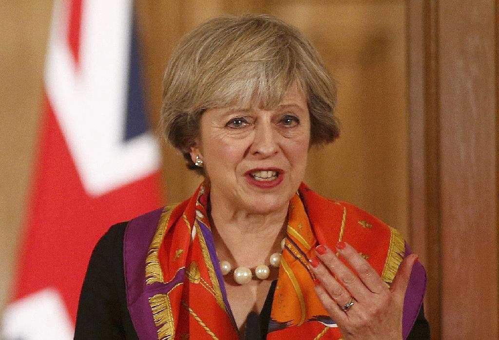 """British Prime Minister Theresa accepts demands to publish her plan for Brexit on the proviso that MPs """"respect the wishes"""" of the June vote to leave the bloc and accept her timetable to trigger Article 50 by the end of March (AFP Photo/PETER NICHOLLS)"""