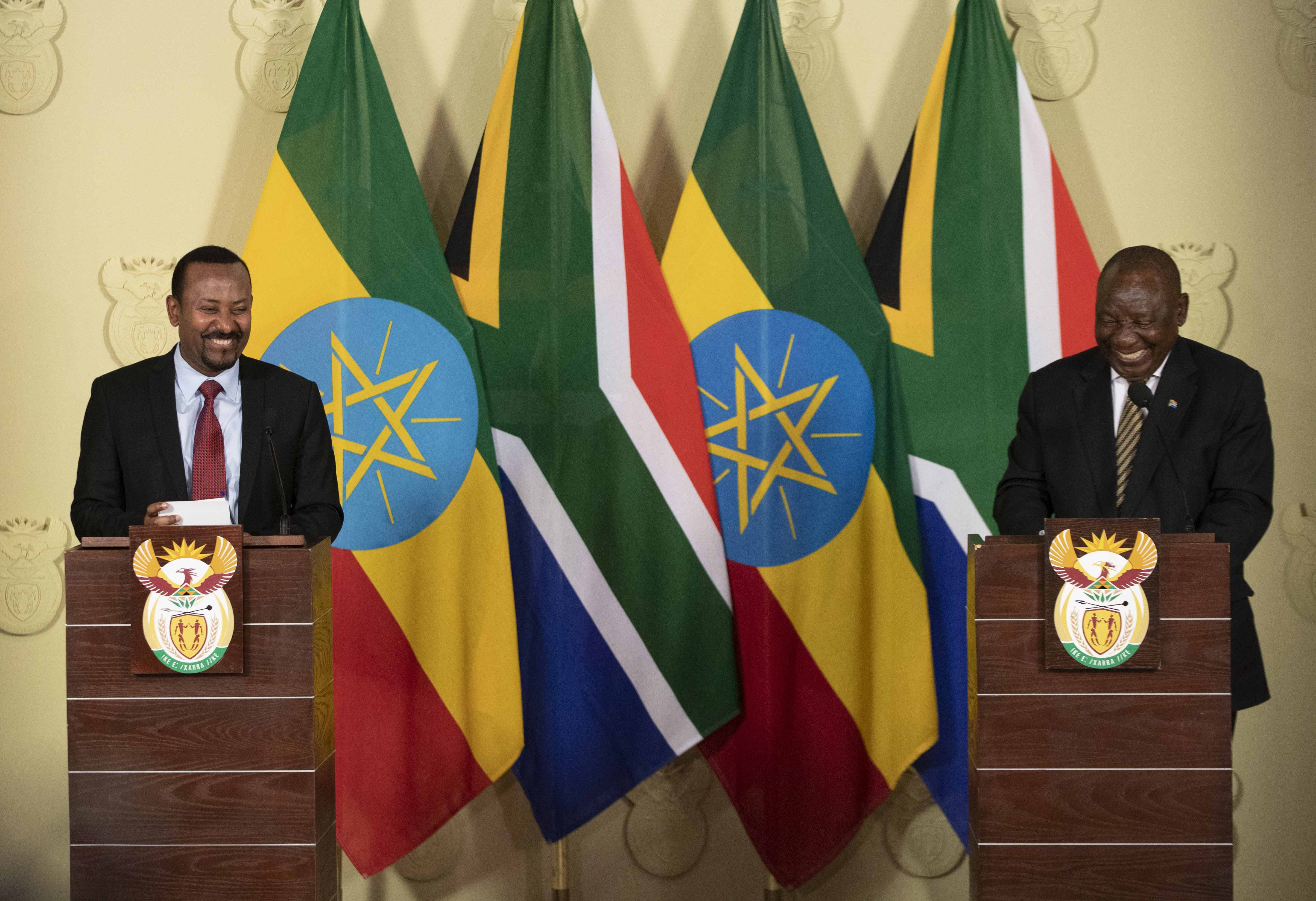 South African President Cyril Ramaphosa, right, shares a light moment with Ethiopia's Prime Minister Abiy Ahmed during their joint media conference at the Union Building in Pretoria, South Africa, Sunday, Jan. 12, 2020. (AP Photo/Themba Hadebe)