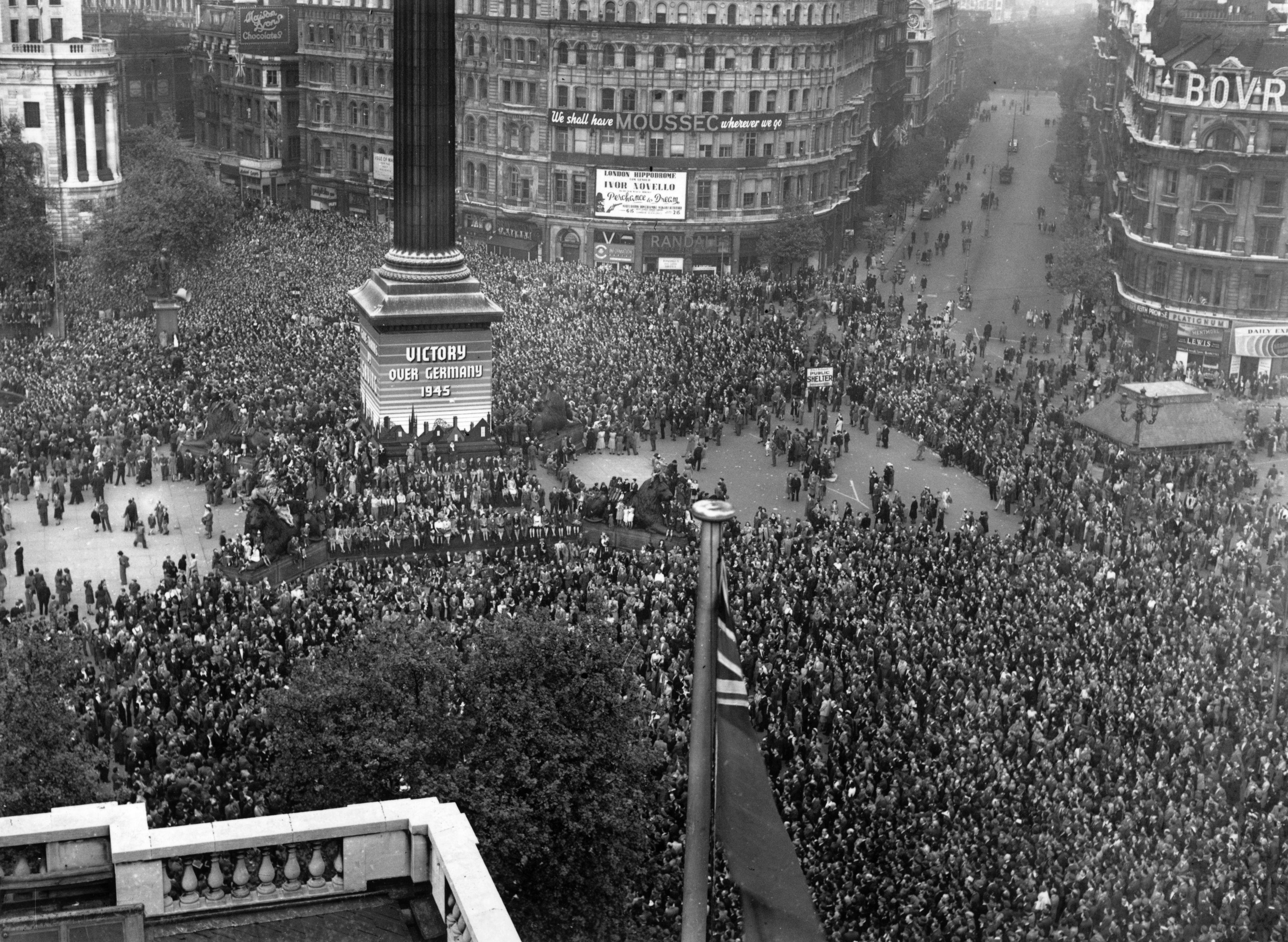 VE day, held to commemorate the official end of World War II in Europe, is celebrated by crowds at Trafalgar Square in London, 8th May 1945. (Photo by Fred Morley/Fox Photos/Hulton Archive/Getty Images)