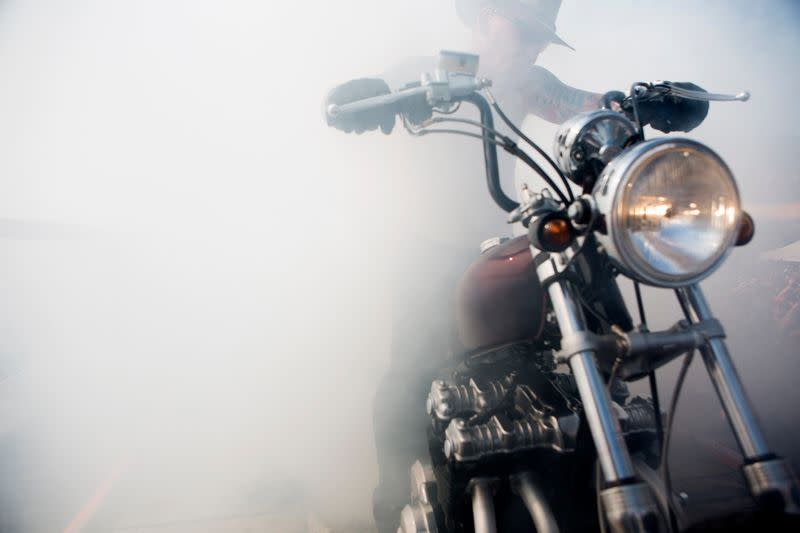 A motorcycle rider does a burnout at Sturgis