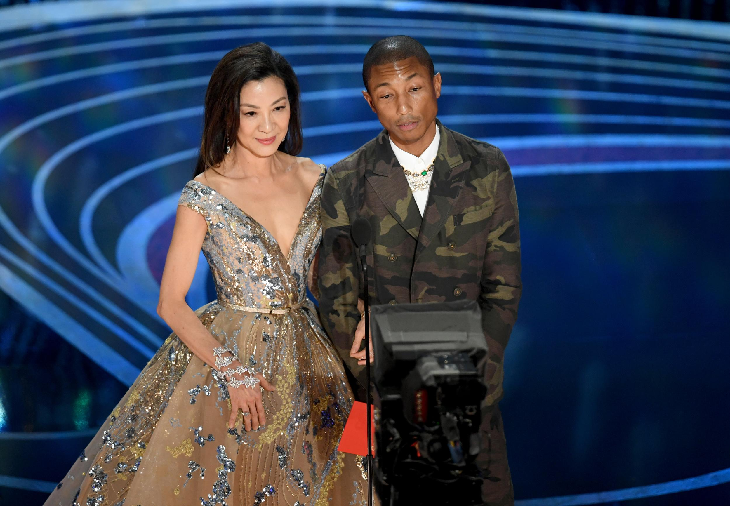 HOLLYWOOD, CALIFORNIA - FEBRUARY 24: (L-R) Michelle Yeoh and Pharrell Williams speak onstage during the 91st Annual Academy Awards at Dolby Theatre on February 24, 2019 in Hollywood, California. (Photo by Kevin Winter/Getty Images)