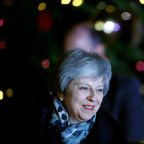 British PM May survives party confidence vote but Brexit deal still teetering