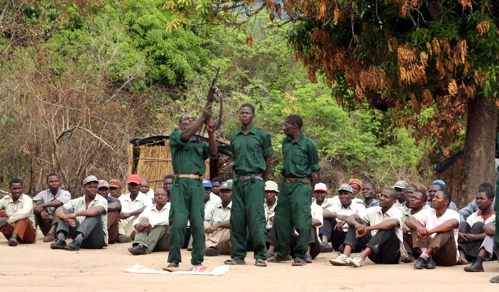 """Fighters of the former Mozambican rebel movement """"Renamo"""" receive military training in Gorongosa's mountains, Mozambique (AFP Photo/Jinty Jackson)"""