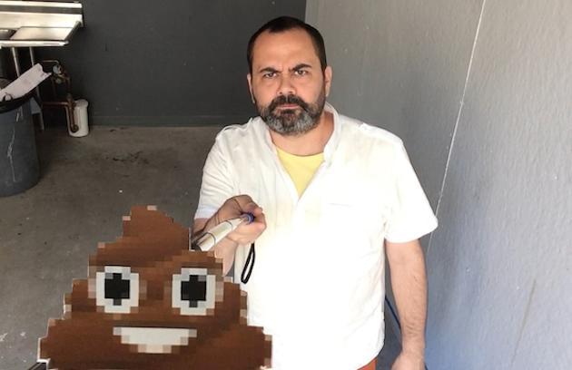 Artist adds poop emoji to selfie sticks to remind us of mortality