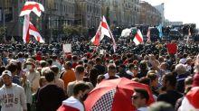 Tens of thousands march in Belarus capital despite massive police presence