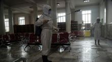 Buses and trains disinfected as North Korea ramps up virus measures