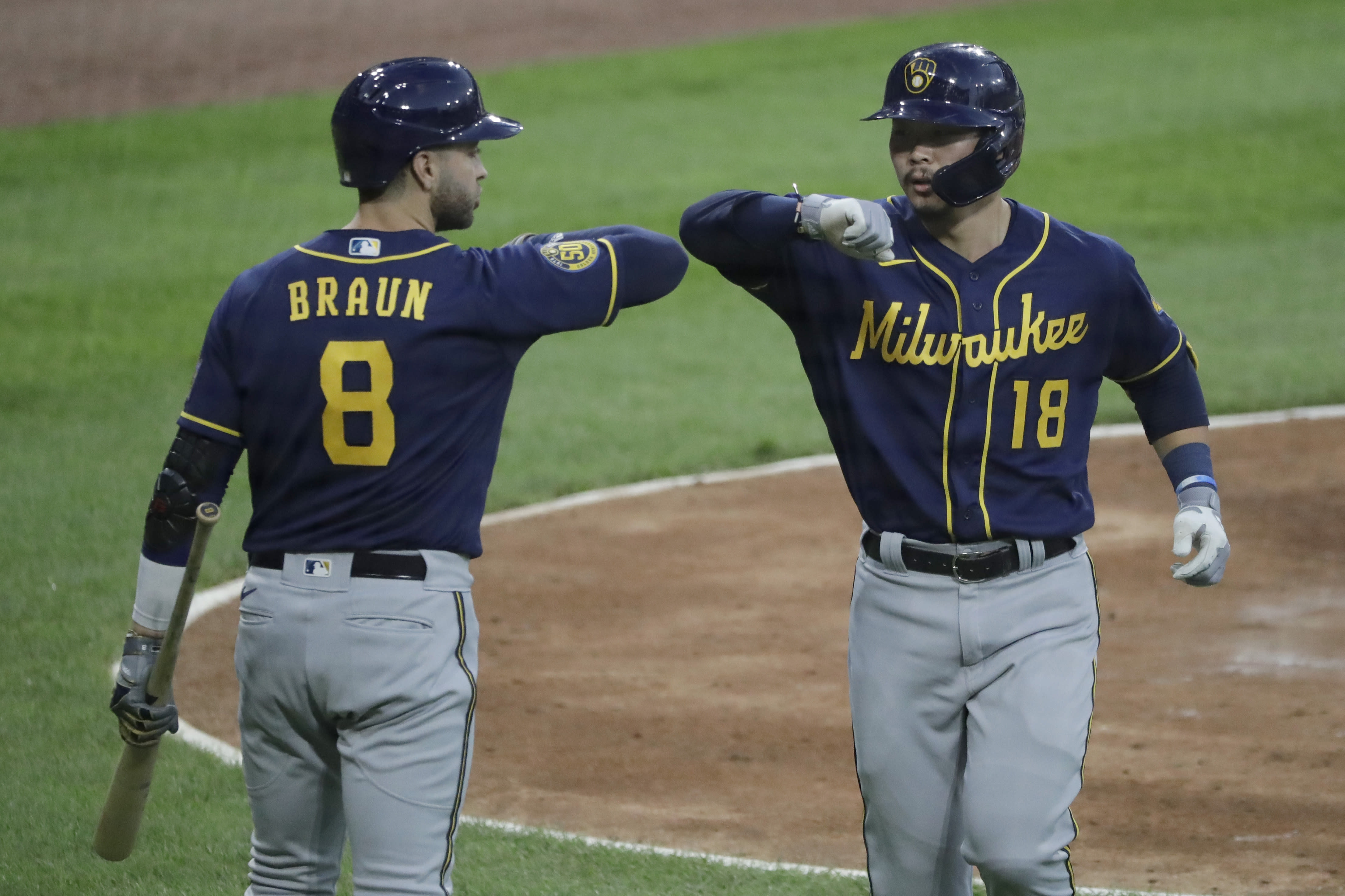 Milwaukee Brewers' Keston Hiura, right, celebrates with Ryan Braun after hitting a solo home run against the Chicago White Sox during the fourth inning of an exhibition baseball game at Guaranteed Rate Field in Chicago, Wednesday, July 22, 2020. (AP Photo/Nam Y. Huh)