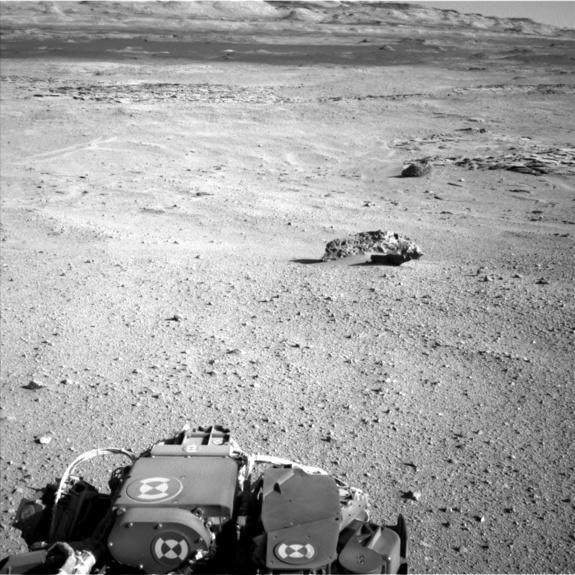 "This photo by NASA's Curiosity rover on Mars shows three meteorites on the Martian surface, the rover's first space rock discoveries, found on May 25, 2014. The larger meteorite in the foreground is ""Lebanon"" (7 feet wide) and has a smaller com"