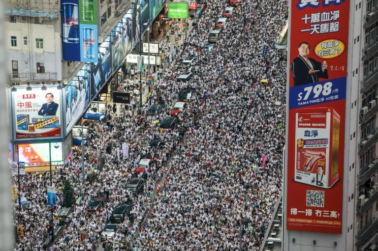 800,000 rally in Hong Kong to mark half a year of protests