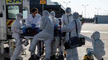 Global virus deaths top 60,000, Trump warns 'tough week' ahead