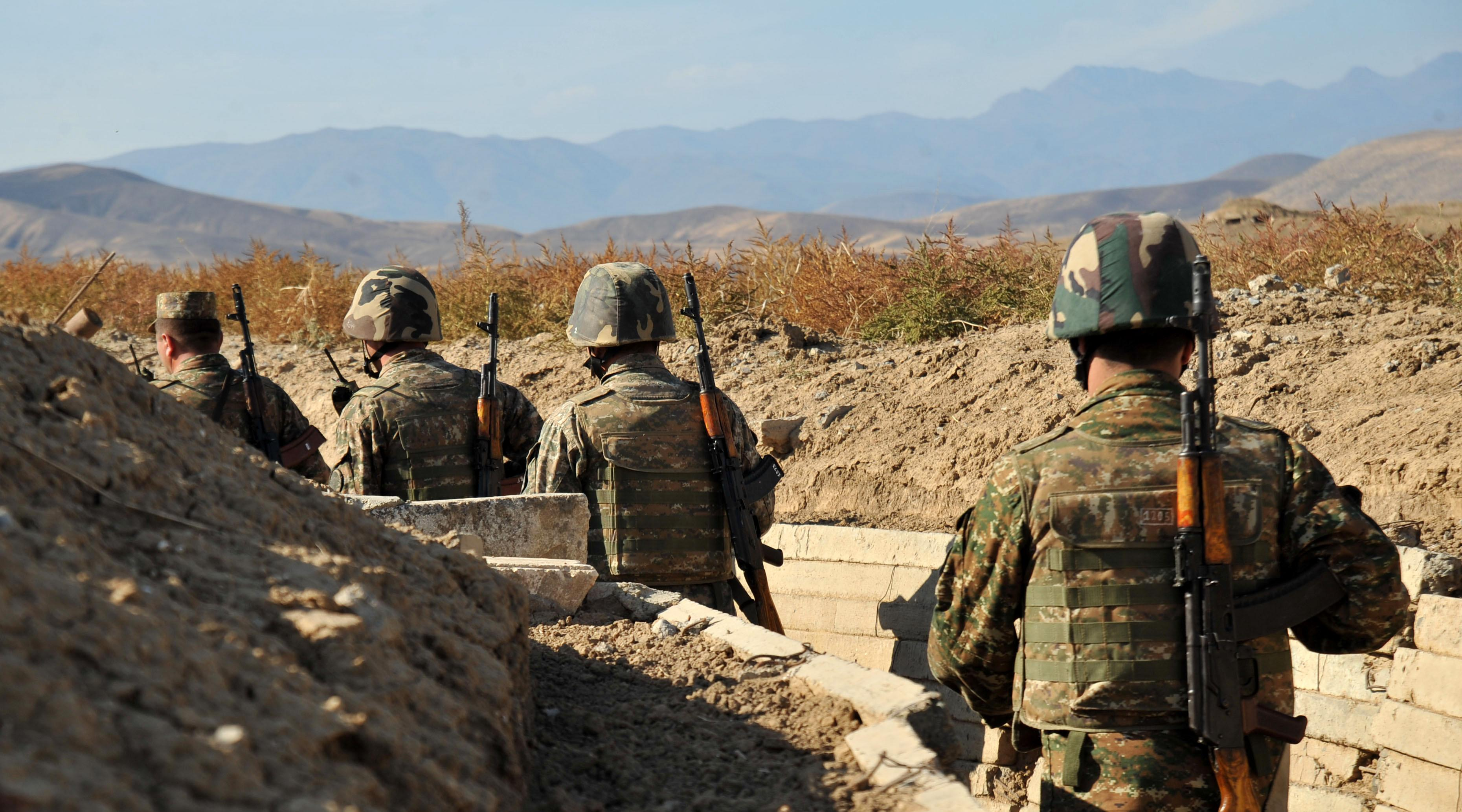 Armenian soldiers with the self-proclaimed Republic of Nagorno-Karabagh walk through trenches at the frontline on the border with Azerbaijan, on October 25, 2012 (AFP Photo/Karen Minasyan)