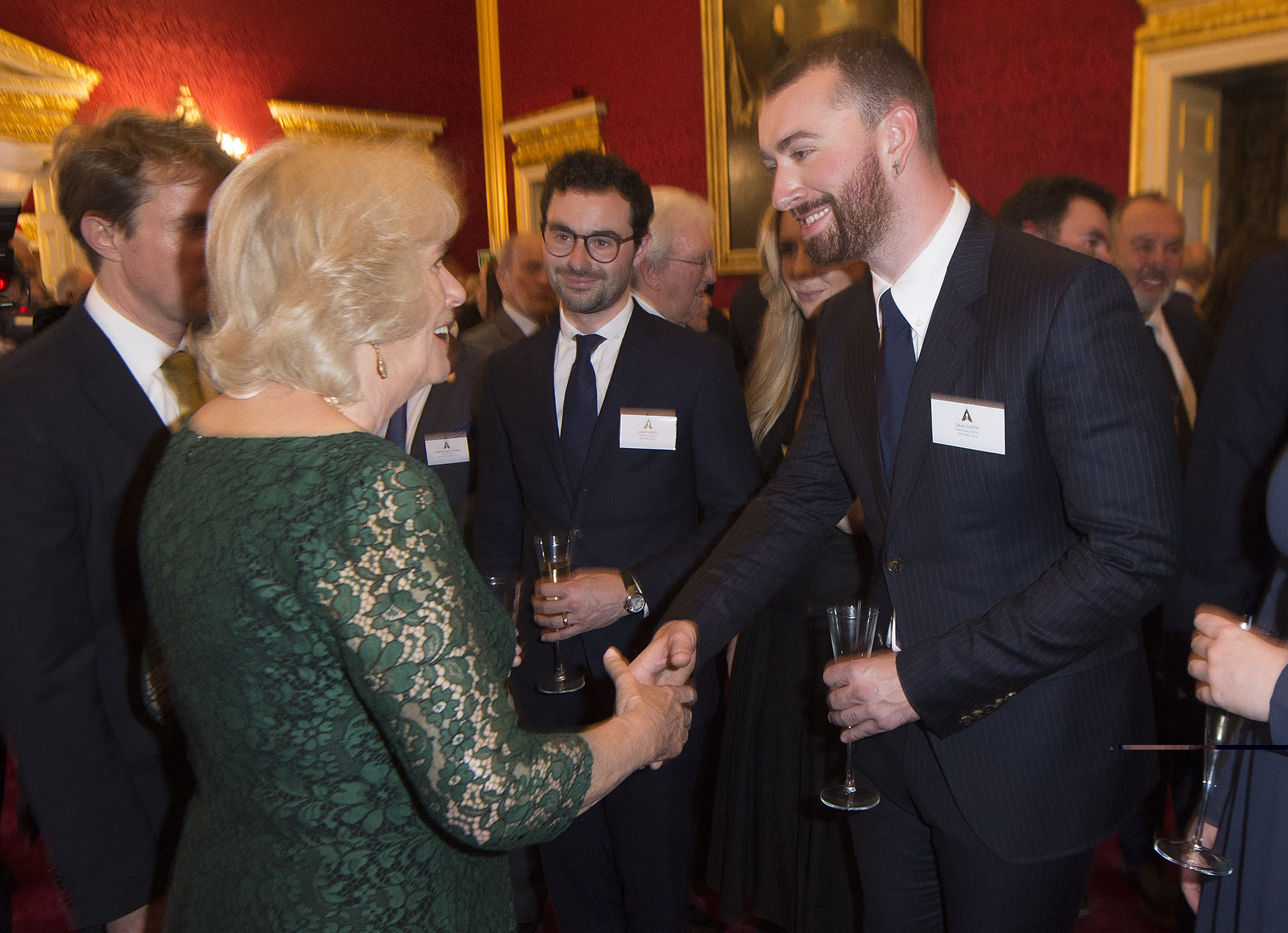 Sam Smith (right) greets the Duchess of Cornwall during a reception for British Academy Awards winners at St James's Palace in London.
