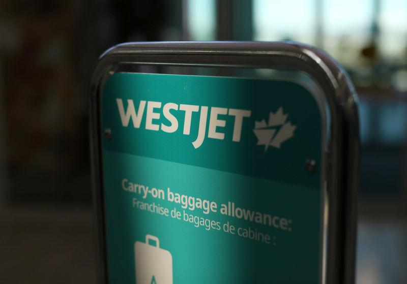 WestJet airline signage is pictured at Vancouver's international airport in Richmond,