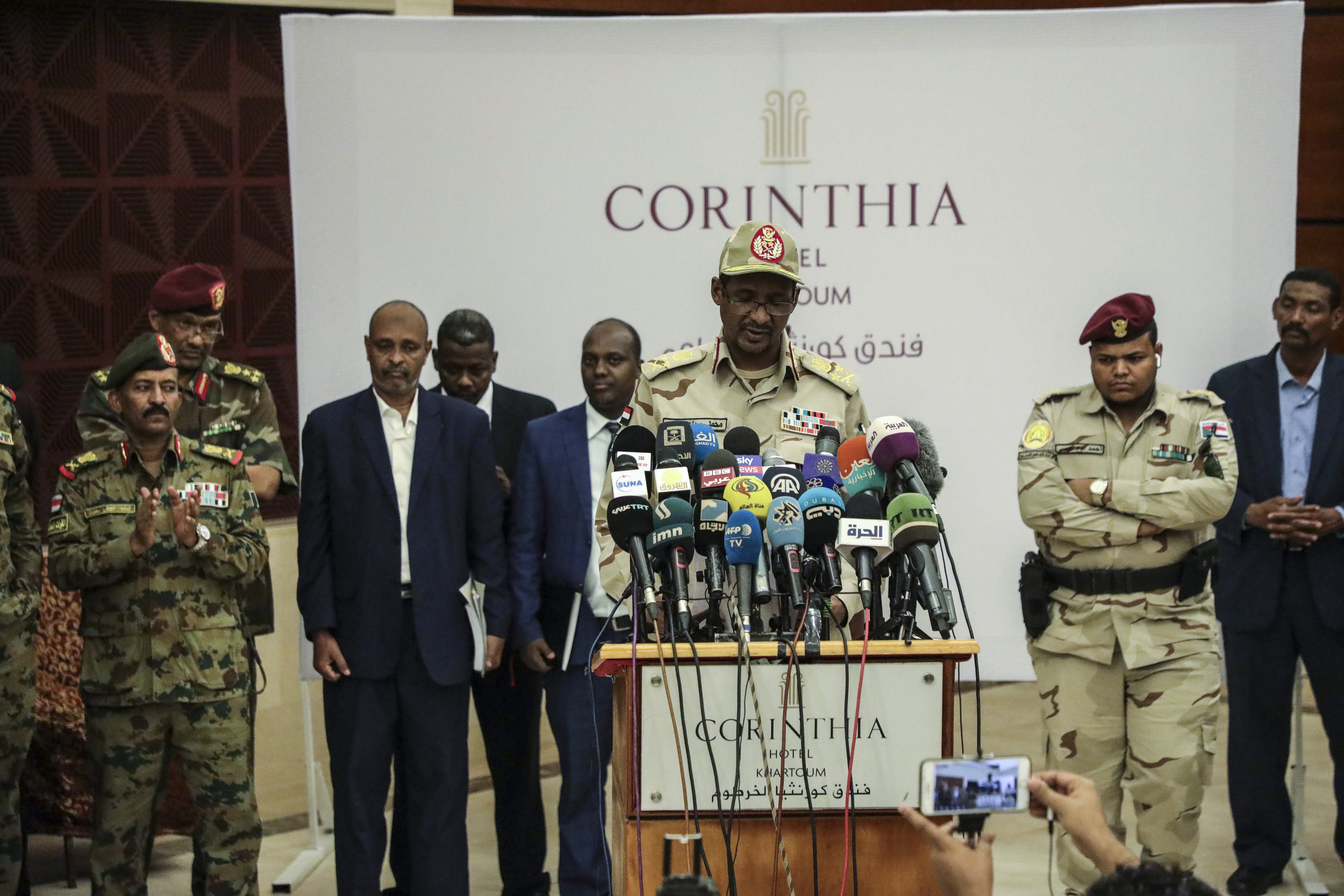 Gen. Mohammed Hamdan Dagalo speaks after signing a power sharing document with Sudan's pro-democracy movement and the ruling military council in Khartoum, Sudan, Wednesday, July 17, 2019. The two sides are still at work on a more contentious constitutional agreement that would specify the division of powers. (AP Photo/Mahmoud Hjaj)