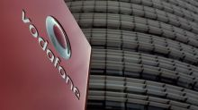 New Vodafone boss tackles debt burden with dividend cut