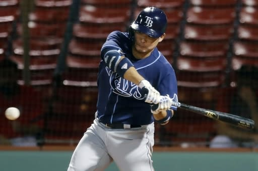 Tampa Bay Rays' Yoshitomo Tsutsugo bats during the seventh inning of a baseball game against the Boston Red Sox, Monday, Aug. 10, 2020, in Boston. (AP Photo/Michael Dwyer)