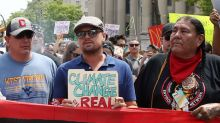 Leonardo DiCaprio used a standard, office file folder for his climate march sign, lol
