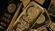 Gold Prices Little Changed as Dollar Gains on Strong U.S. Inflation