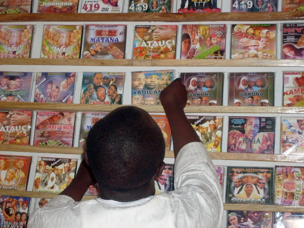 A customer searches for local Hausa films, known as Kannywood, popular among the residents of northern Nigeria's city of Kano