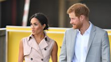 Duchess of Sussex wears sleeveless trench dress and trademark messy bun for Nelson Mandela exhibition in London