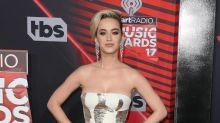Katy Perry hands out cherry pie to fans in New York