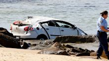Car drives off cliff, hitting mum and daughter on beach below