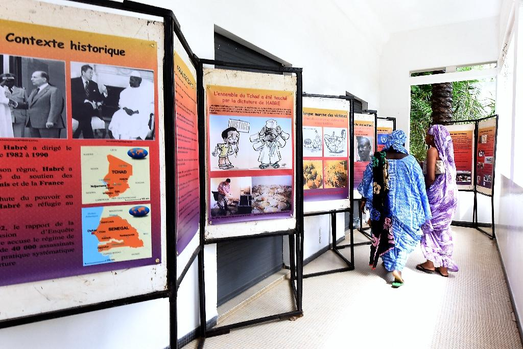 Visitors view an exhibition depicting the years under which Chad was ruled by dictator Hissene Habre, on July 15, 2015 at the Douta Secke Cultural Center in Dakar (AFP Photo/Seyllou)