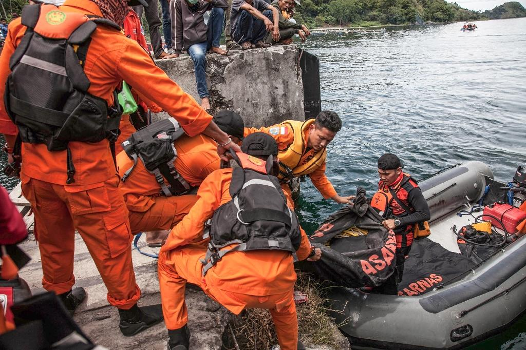 Search teams continue to hunt for bodies in Indonesia's Lake Toba - which is up to 500 metres deep in places - as authorities detained the captain of the overloaded ferry that sank Monday (AFP Photo/IVAN DAMANIK)