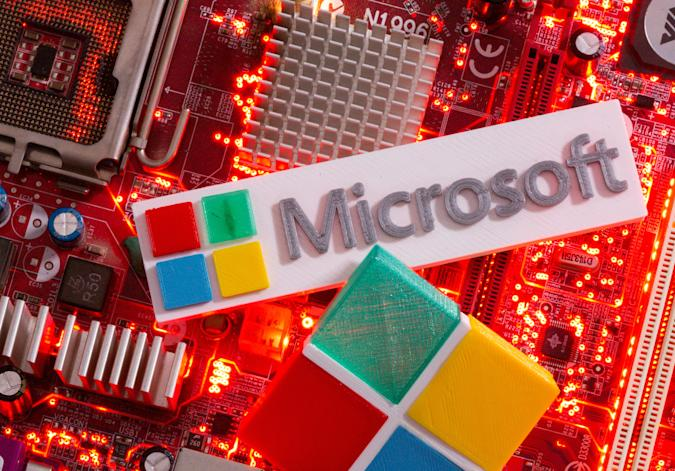 3D-printed Microsoft logos are seen on a computer motherboard in this picture illustration taken July 22, 2021. REUTERS/Dado Ruvic/Illustration