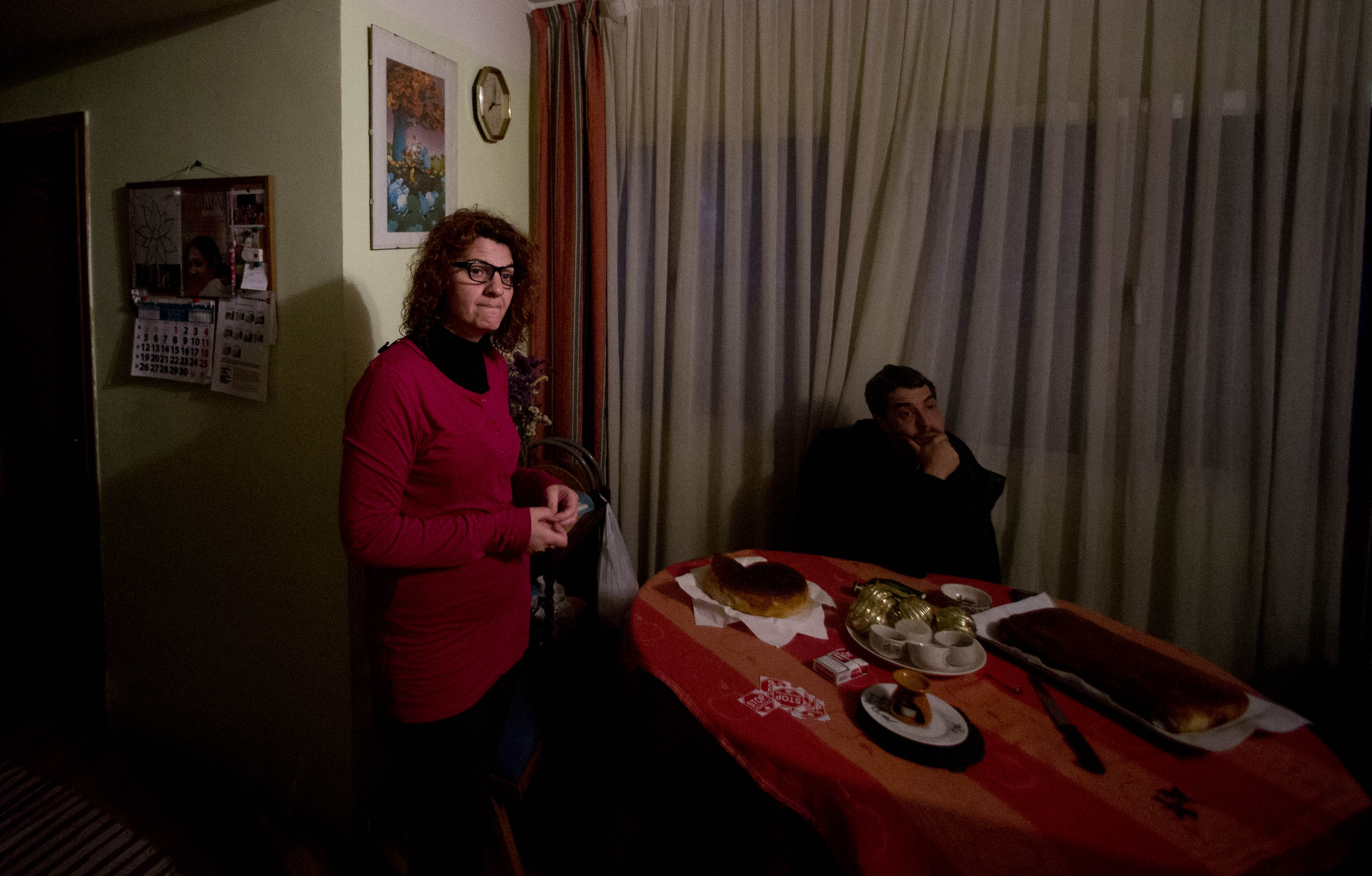 45-year old office manager Irene Gonzalez of Spain, left waits with a friend, to be evicted from her home, in Madrid, Monday Nov. 19, 2012. The police and court officials did not show up at the planned time and she still does not know if they will come later or on another day to evict her. Spain recently approved a two-year suspension of evictions for some needy homeowners unable to pay their mortgages, but activists said the government failed to address the larger issue of how those who give up their homes may still remain indebted, sometimes for the rest of their lives. Public attention on the issue intensified greatly in recent weeks after two homeowners facing eviction committed suicide. (AP Photo/Paul White)
