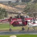Firefighters Load Helicopter Water Tanks to Combat Woolsey Fire in Malibu