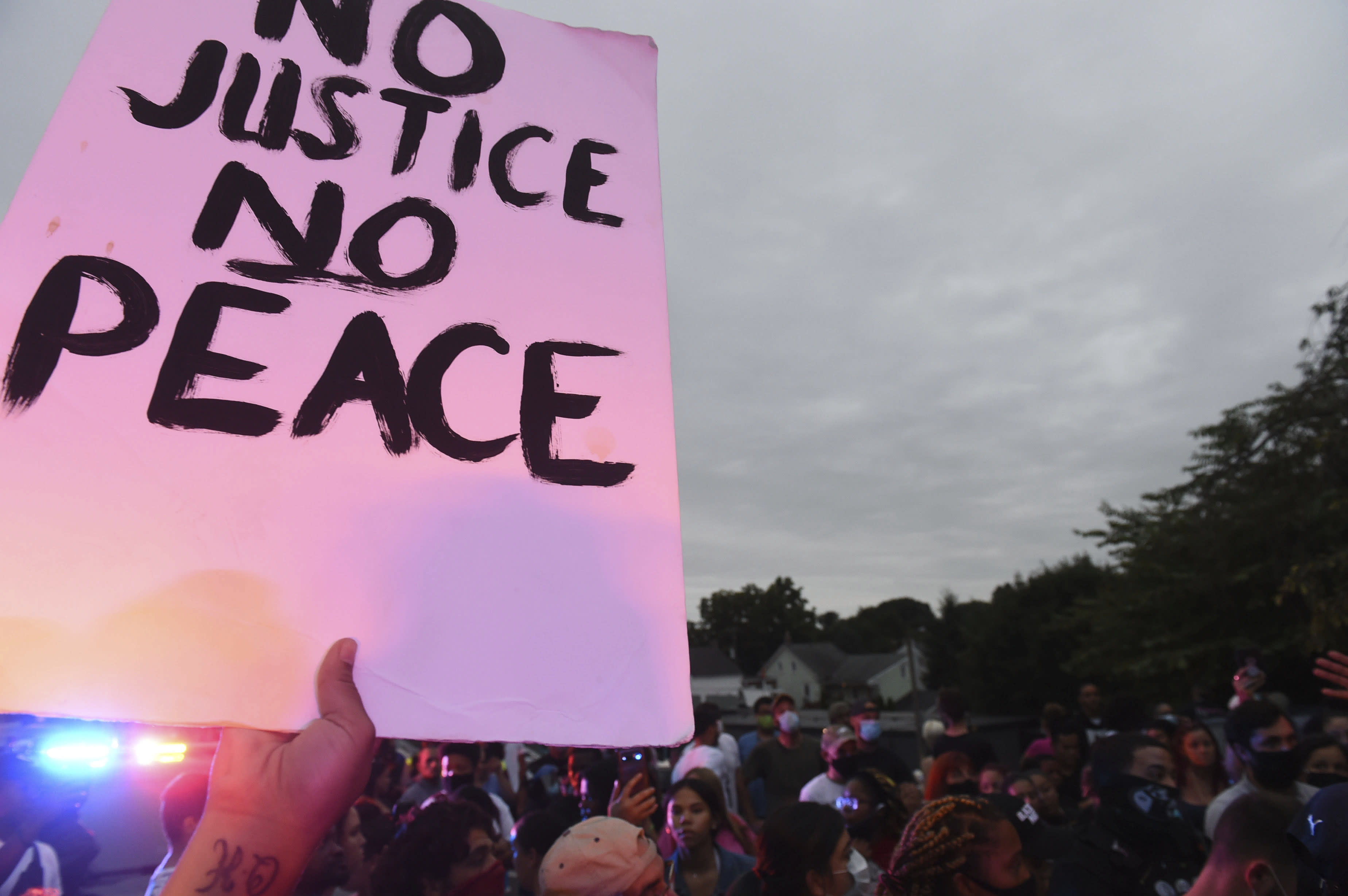 A sign at a protest at the scene of a police shooting on Laurel Street and Union Street in Lancaster city on Sunday, September 13, 2020. A man was shot by police earlier in the day after a reported domestic dispute, police said. A Lancaster city police officer fired at a 27-year-old man who was armed with a knife. The man, identified as Ricardo Munoz, was killed and pronounced dead at the scene. (Andy Blackburn/LNP/LancasterOnline via AP)