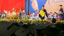 UM protest grad to get his scroll, degree not withheld
