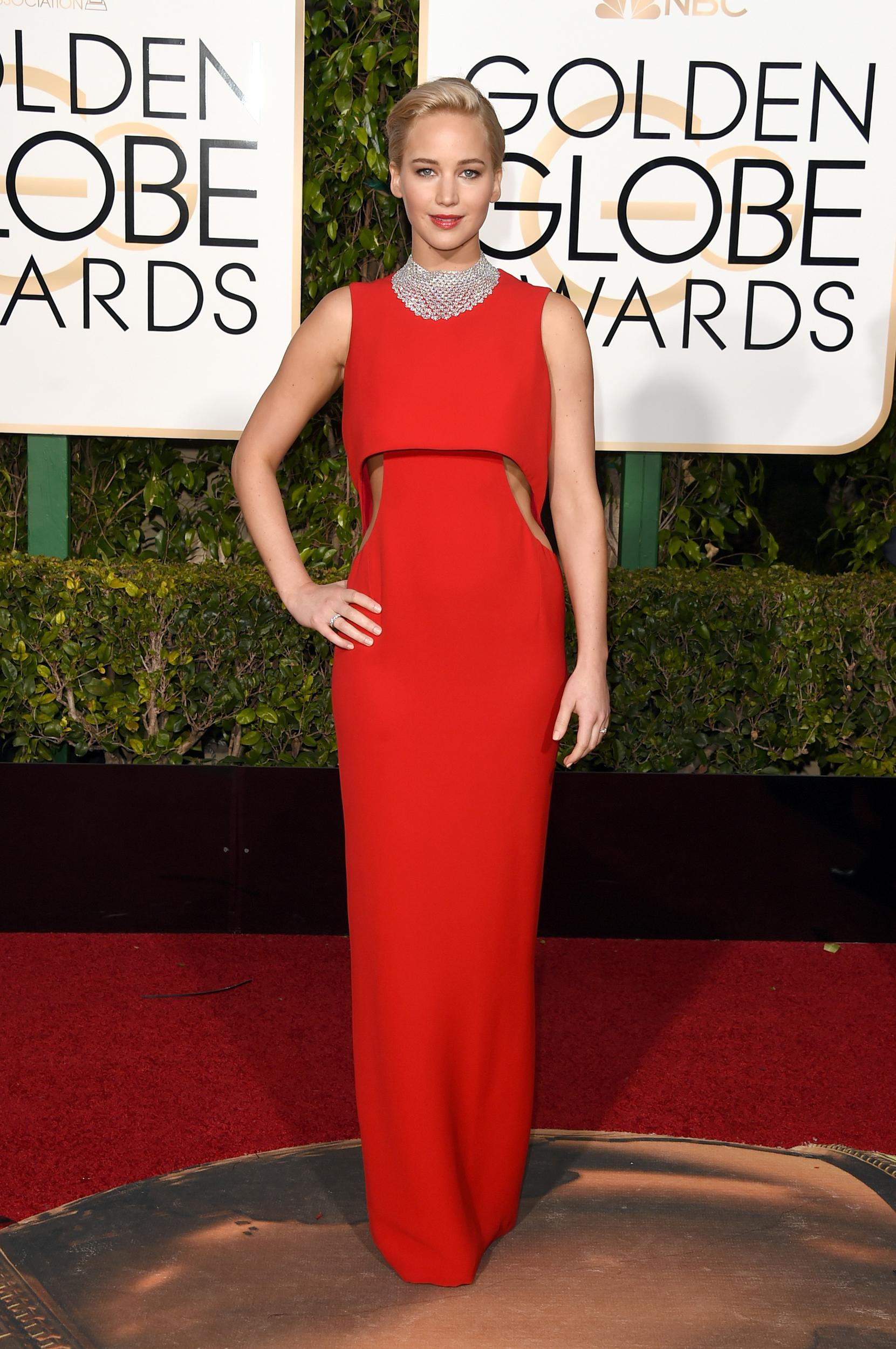 Jennifer Lawrence was an absolute knockout in a red Dior dress with sleek cutouts along the waist. She topped off her classic and glamorous look with a diamond choker, red lips and swept back locks. (Photo by Jason Merritt/Getty Images)