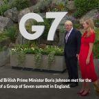 Bidens and Johnsons bump elbows outside G-7 venue
