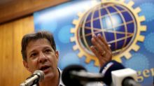 Brazil's right-wing candidate scolds son for threat to shut top court