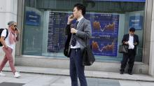 World shares mixed after Wall St retreat, weaker Japan data