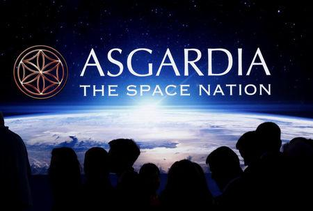 People attend the inauguration ceremony of Asgardia's first Head of Nation in Vienna, Austria June 25, 2018. REUTERS/Lisi Niesner
