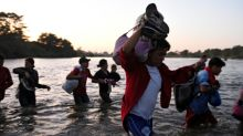 Hundreds of Central American migrants cross into Mexico from Guatemala