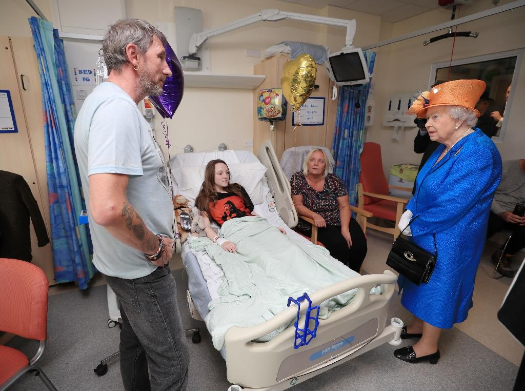 """Britain's Queen Elizabeth II made a rare visit to see some of the wounded children, describing the attack as """"very wicked"""" (AFP Photo/Peter Byrne)"""