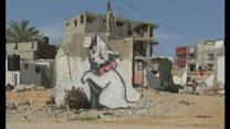 Banksy paints graffiti on remains of Gaza home