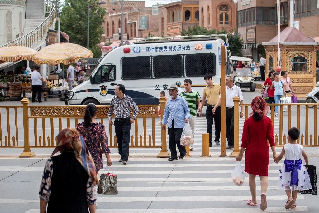 The rights group said its findings suggest authorities track data of everyone in Xinjiang by monitoring location data from their phones, ID cards and vehicles (AFP Photo/Johannes EISELE)