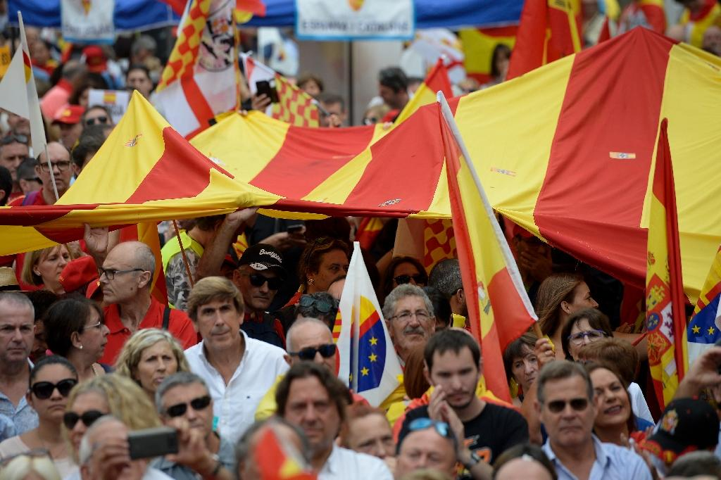 "People wave Spanish and Catalan flags at an anti-separatist rally on Spanish national day in Barcelona where they demanded ""the unity of Spain and Catalan society which is more and more divided"""