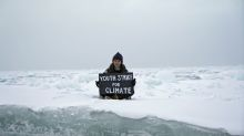 Teenage British activist stages climate protest on Arctic ice floe