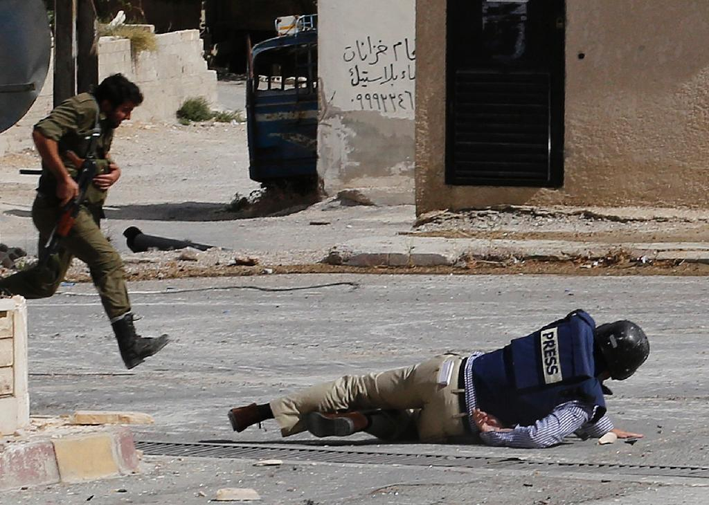 War-torn Iraq and Syria were the most dangerous places in the world this year for journalists, with 11 and 10 fatalities respectively (AFP Photo/Anwar Amro )