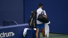 US Open day seven: Novak Djokovic defaulted for hitting line judge with a ball