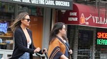 Chrissy Teigen pushing a stroller in thigh-high stilettos is off-duty mom style goals
