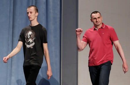 Ukrainian filmmaker Oleg Sentsov and activist Oleksandr Kolchenko arrive for a news conference in Kiev
